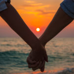 Couple Holding Hands at Sea Sunset -aroma de mujer